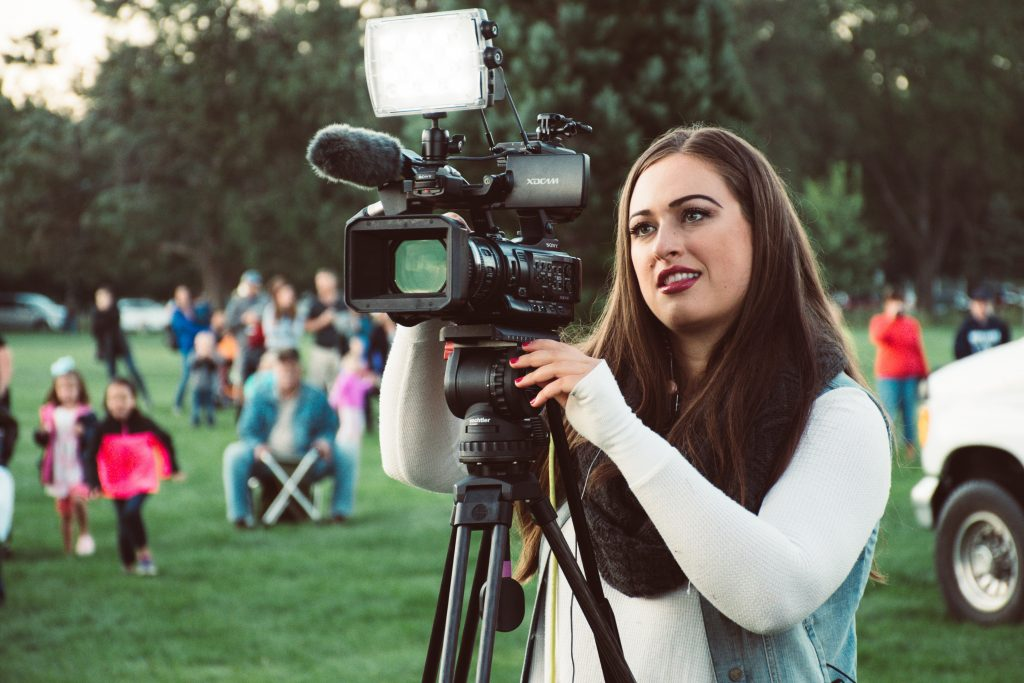 Photo of a woman using a video camera